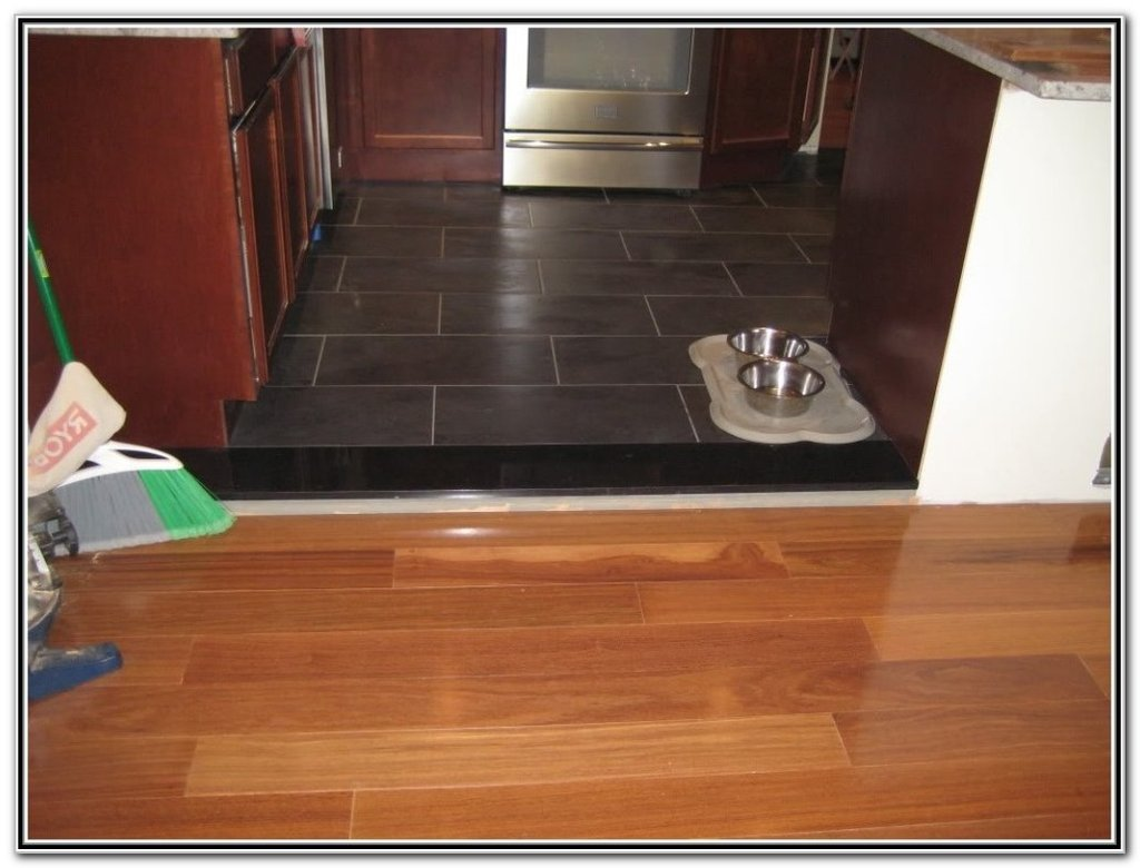 Ugly Uneven Floor Transition Area Radiant Floor Installing Strip Of Laminate Flooring Transition