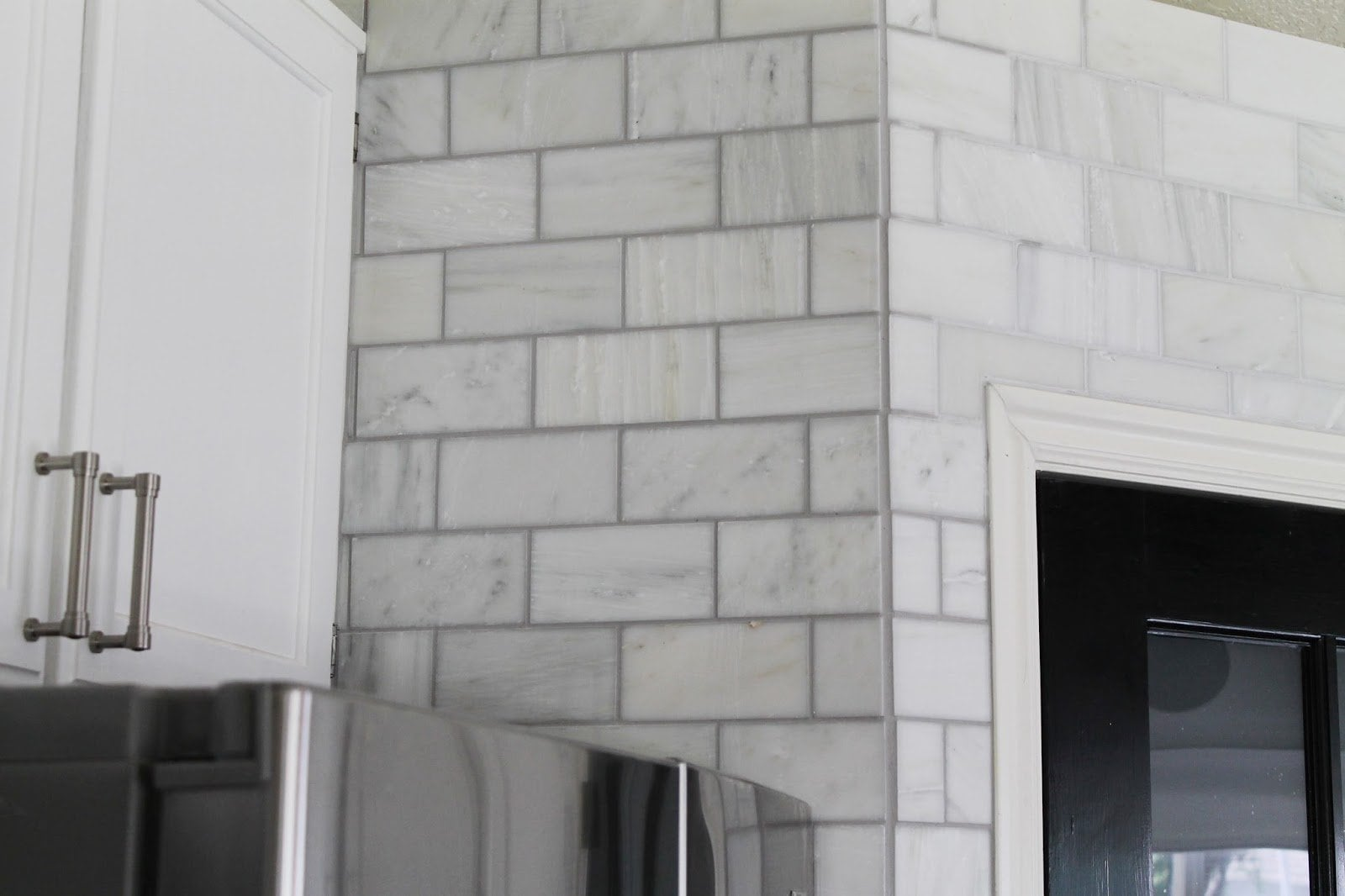 Carrara Marble Tile Fireplace